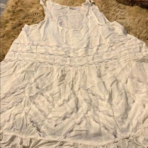Free People lace embellished tank top.